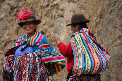 Sacred Valley, women, happy, traditional dress, carrying baby on back, Cusco, peru